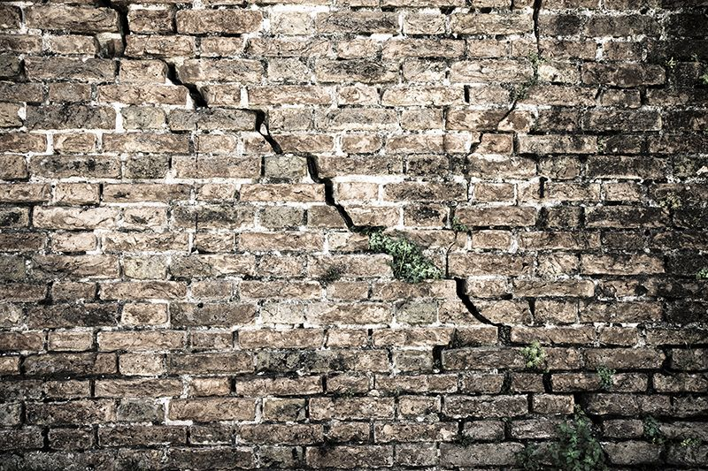A cracked wall could be caused by a failing foundation due to expansive soil problems.